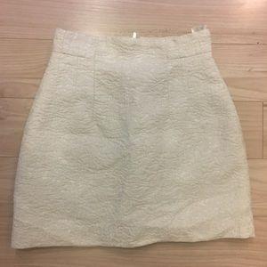 Ivory textured mini skirt